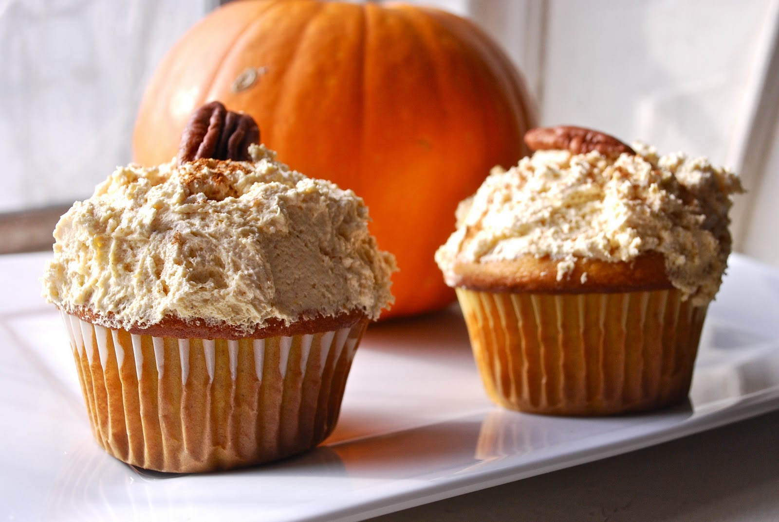 Pumpkin Cupcakes with Spiced Cream Cheese Frosting - The ...